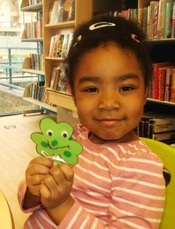 Making shamrock faces for St Patrick's Day 2017 at Kensal Library